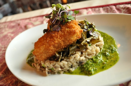 """Pan-seared tofu with cremini mushroom risotto and herb sauce. Pictured here with collard greens. From The Washington Post's """"Washington's essential vegetarian eats"""""""