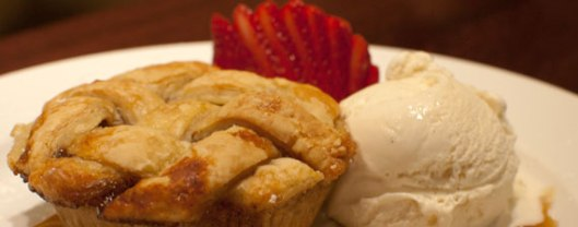 Mni apple pie served with vanilla ice cream