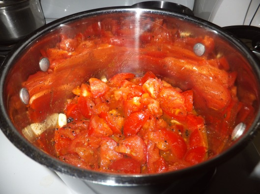 Tomatoes, garlic and spices added