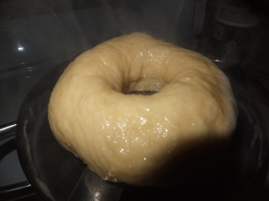 A boiled bagel, ready to bake